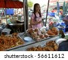 CHAING MAI, THAILAND - JUNE 22: Thai woman sells fried seafood and chicken on June 22, 2005 in Chaing Mai. - stock photo