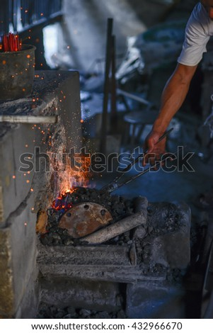 CHAING MAI,THAILAND-MAY 27,2016: Blacksmith work a Retro smithy in Chiang Mai province Thailand.