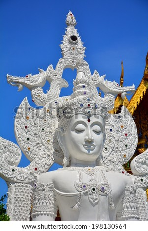 CHAING MAI, THAILAND - MAY 11, 2014 : White Buddha at Wat Tung Yu is a small Buddhist monastery near Wat Phra Singh, in the old city of Chiang Mai. It is small, but contains a lot of interesting architectures - stock photo