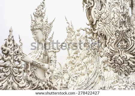 CHAING RAI,THAILAND-APRIL 3,2015: Beautiful details of an angel statue in Wat Rong Khun or the famous White Temple in Chiang Rai Province.