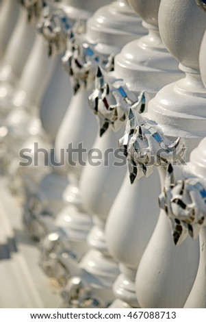 CHAING-RAI-THAILAND-DECEMBER 7 : Decorative Thai style stucco at  Wat Rong Khun, the famous white temple of Thailand on December 7, 2015, Chaing Rai Province, Thailand