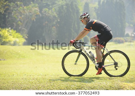 CHAINGMAI, THAILAND- FEBRUARY  13, 2016:Man ride a bike  exercises in park at Chaingmai province north Thailand.