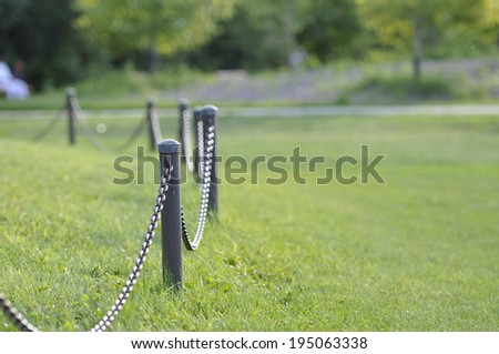 chains fence in the park  - stock photo