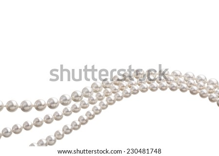 Chains of white pearls forming an ornament - stock photo