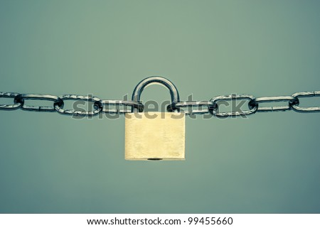 Chains with a key-lock on a dark background - stock photo
