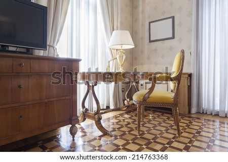 Chair and desk in classic style room - stock photo
