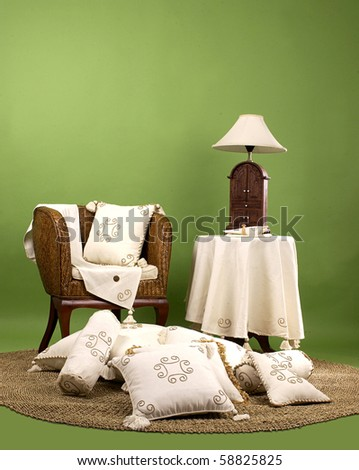chair and desk made from straw; living room furniture isolated on green background - stock photo