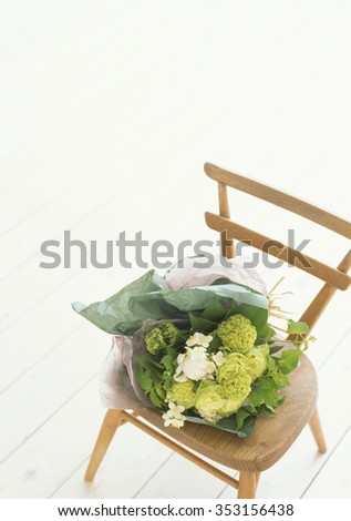 chair and flowers - stock photo