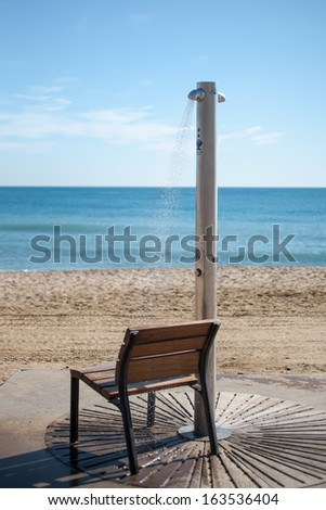 Chair and shower on a beach in Barcelona - stock photo