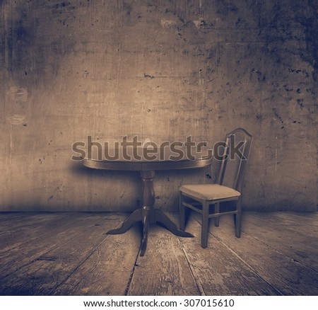 chair and table in old grunge interior, retro filtered, instagram style - stock photo