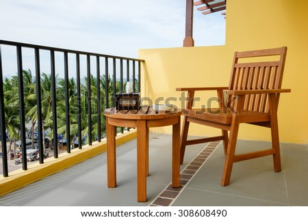 Chair and table on balcony of the resort, see view Bangsean sea - stock photo