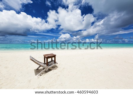 Chair and table on the white beach