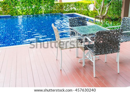 chair around beautiful luxury swimming pool in hotel resort - boost color up processing style