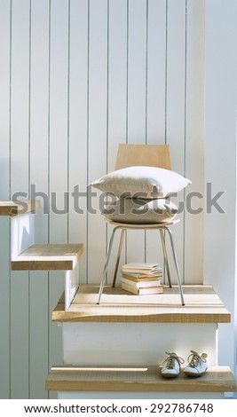 Chair decorated with staircase - stock photo