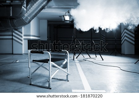 Chair for director in studio on a background of a smoke - stock photo