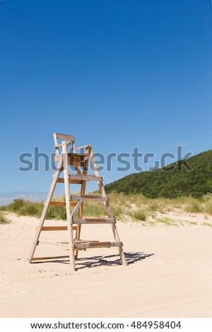 Chair in a beautiful beach empty at summer
