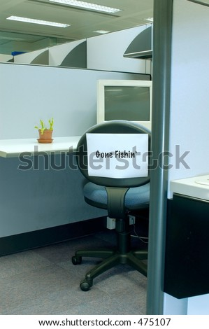 chair in cubicle with Gone fishing sign - stock photo