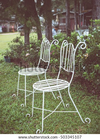 chair in garden with vintage filter