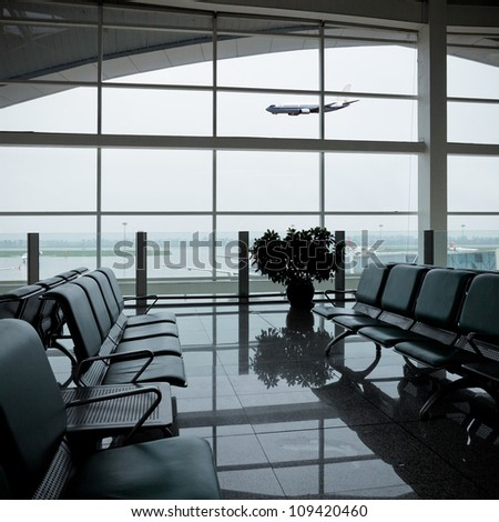 chair in the hall of airport,waiting for the flight - stock photo