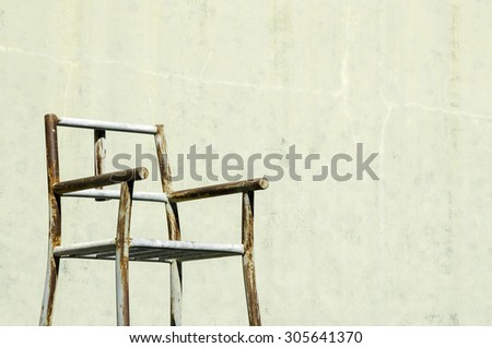 chair in the old tennis court  - stock photo
