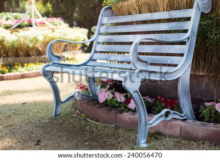 Chair in the park in spring time  - stock photo