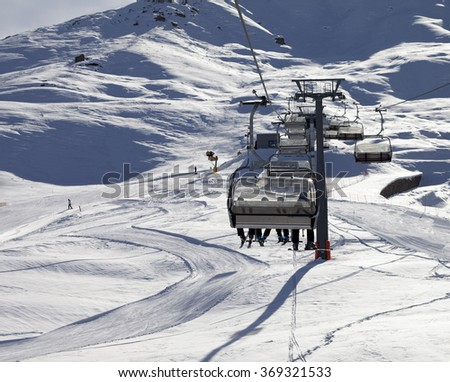 Chair-lift and ski slope at sun evening. Greater Caucasus, Shahdagh. Qusar rayon of Azerbaijan.