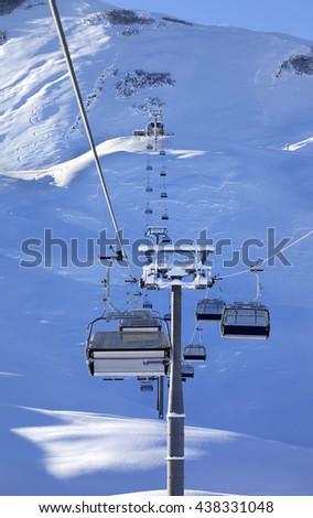 Chair-lift at early morning after snowfall. Greater Caucasus, Mount Shahdagh. Qusar rayon of Azerbaijan. - stock photo