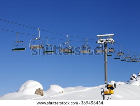 Chair-lift at ski resort at sun day after snowfall. Greater Caucasus, Mount Shahdagh. Qusar rayon of Azerbaijan. - stock photo