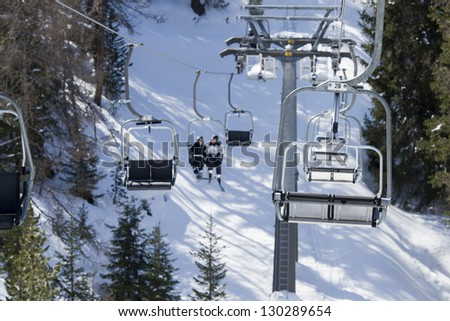 Chair Lift for skiers in winter snow time - stock photo