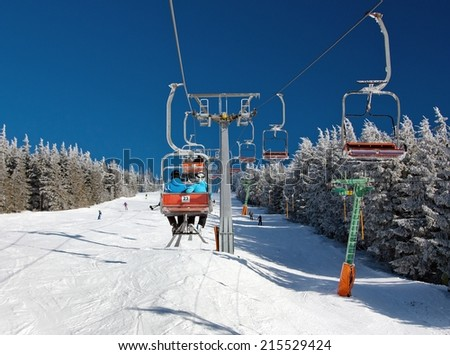 chair lift on mountain for downhill skiers  - stock photo