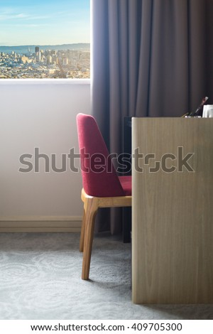 chair near the window in bedroom  - stock photo