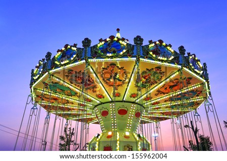 Chair-O-Planes at night in a theme park , Cha-am Thailand  - stock photo