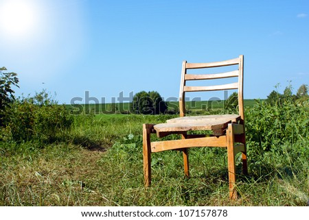 Chair on a green meadow - stock photo