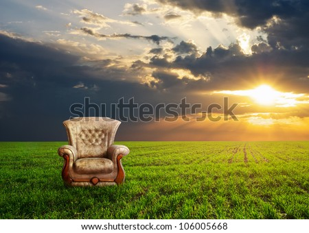 Chair on a green meadow. Concept design. - stock photo
