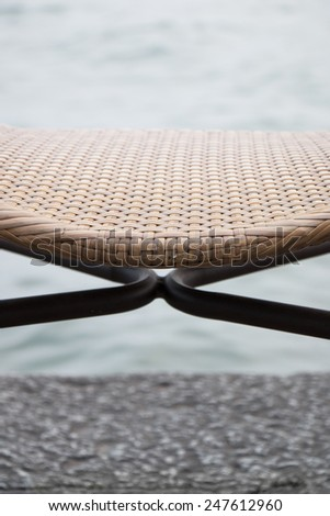 Chair on the river, close up with copy writing space - stock photo