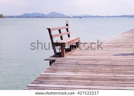 Chair on wooden bridge.