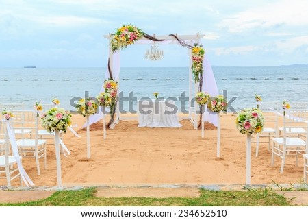 chair setting with flower decoration for wedding at the beach - stock photo