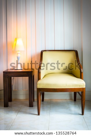 chair with desk lamp in the interior - stock photo