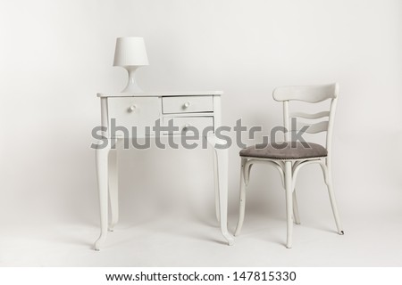 chair with side table and lamp - stock photo