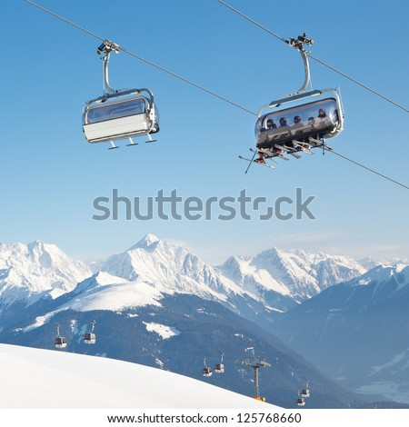 Chairlift at alpine ski resort on a clear winter day. - stock photo