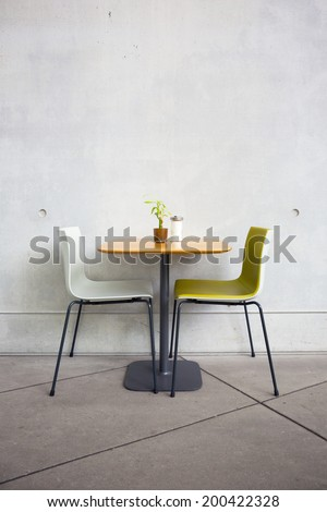 chairs and table at open-air cafe - stock photo
