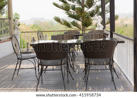 chairs and table with nice view on mountain outside home exterior