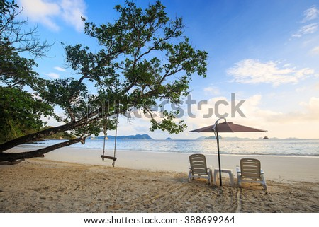 chairs and umbrella on sand beach at Nyaung Oo Phee Island, Andaman sea, Myanmar - stock photo