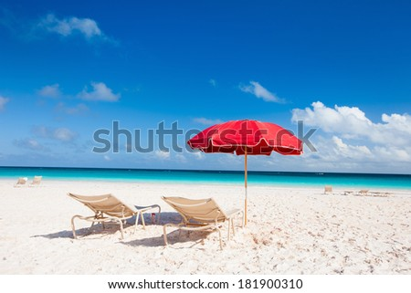 Chairs and umbrellas on a tropical beach at Bahamas - stock photo