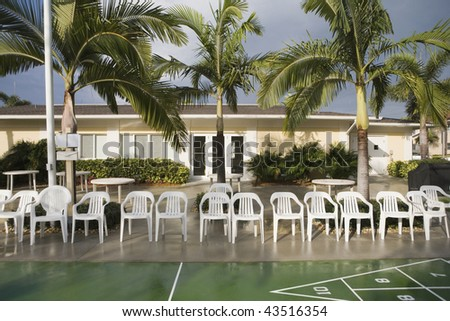 Chairs at a shuffleboard court - stock photo