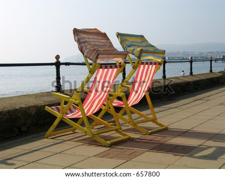 Chairs at seaside - stock photo