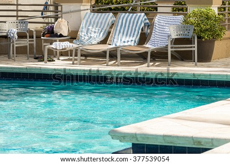 Chairs at the swimming pool - stock photo