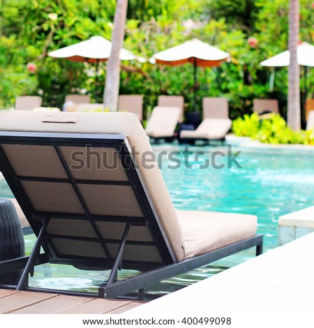 chairs by the pool - stock photo