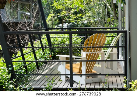 Chairs for relaxing in front of the house - stock photo