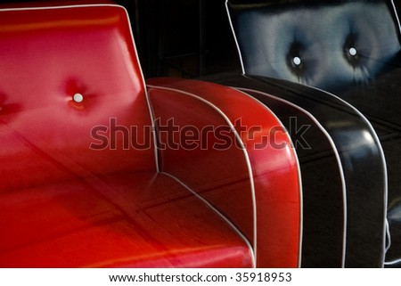 chairs in a store window reflect the sidewalk - stock photo